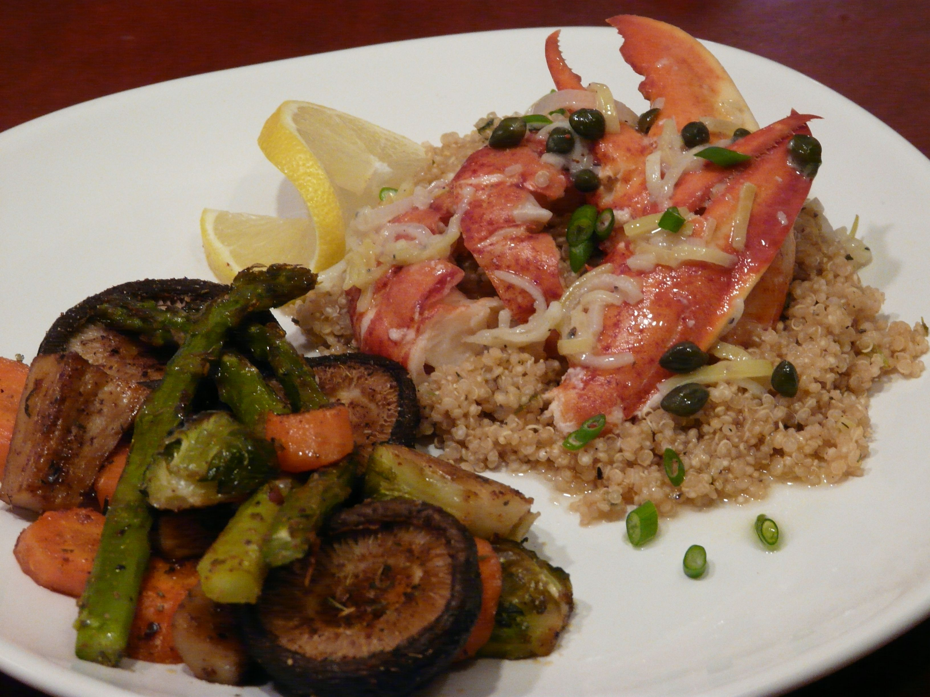Succulent lobster served over lemon scented quinoa and drizzled with lemon, shallot and caper butter, & accompanied by oven roasted vegetables.