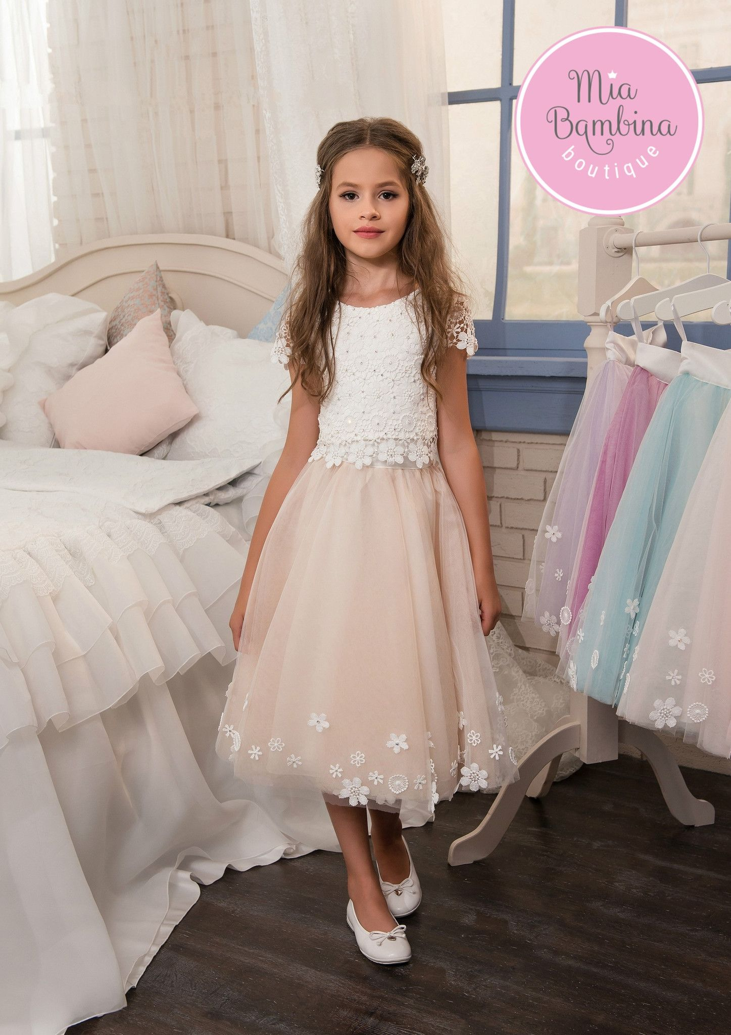 1caaee026 Adorable 2-piece outfit for flower girls features a short sleeved lace over  satin top