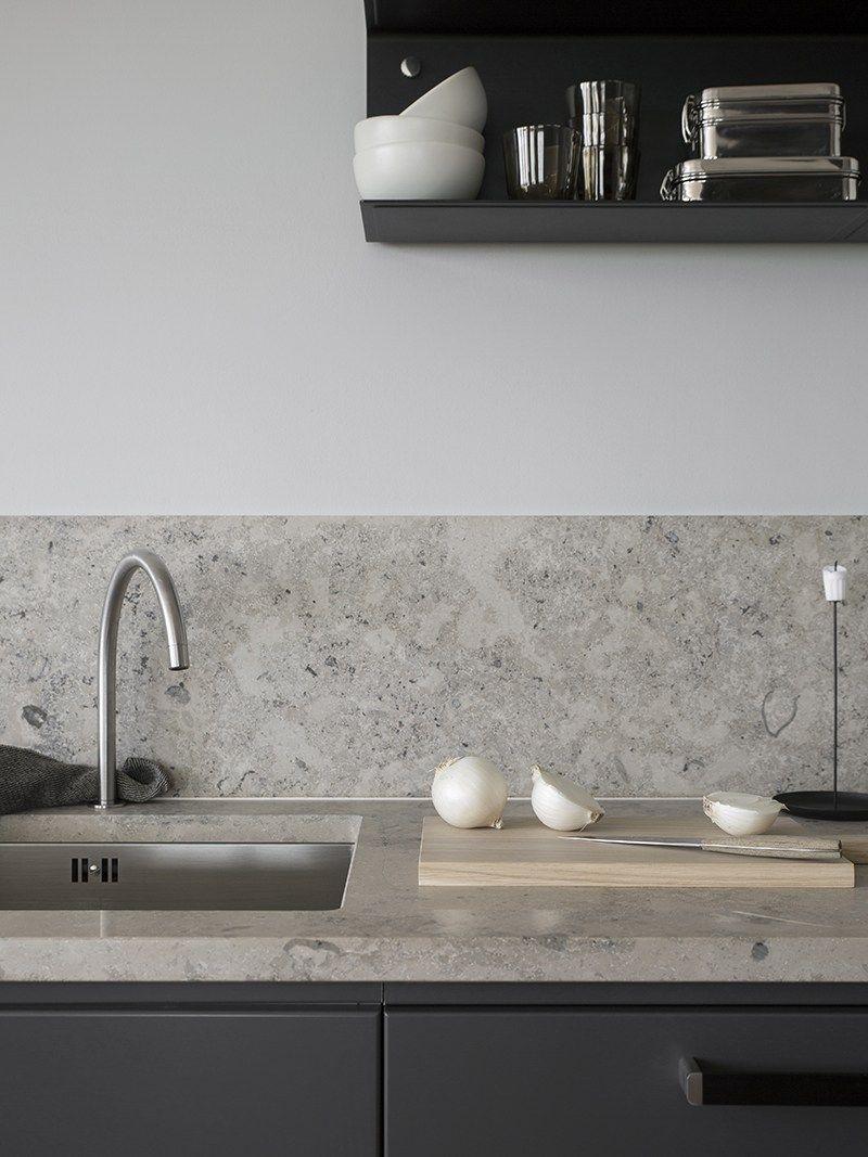 Dark grey kitchen with a natural stone top #greykitchendesigns