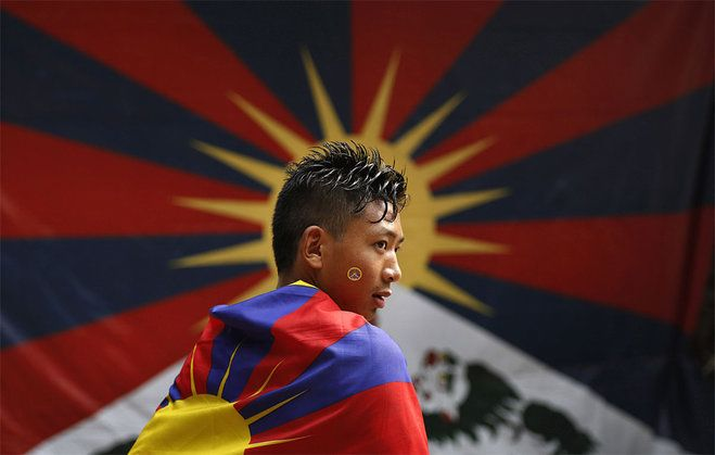 Aptopix India Tibet China Protest A Tibetan Exile Wears A Tibetan Flag While Participating In A Protest Rally I Tibet Human Rights Council Pictures Of The Week