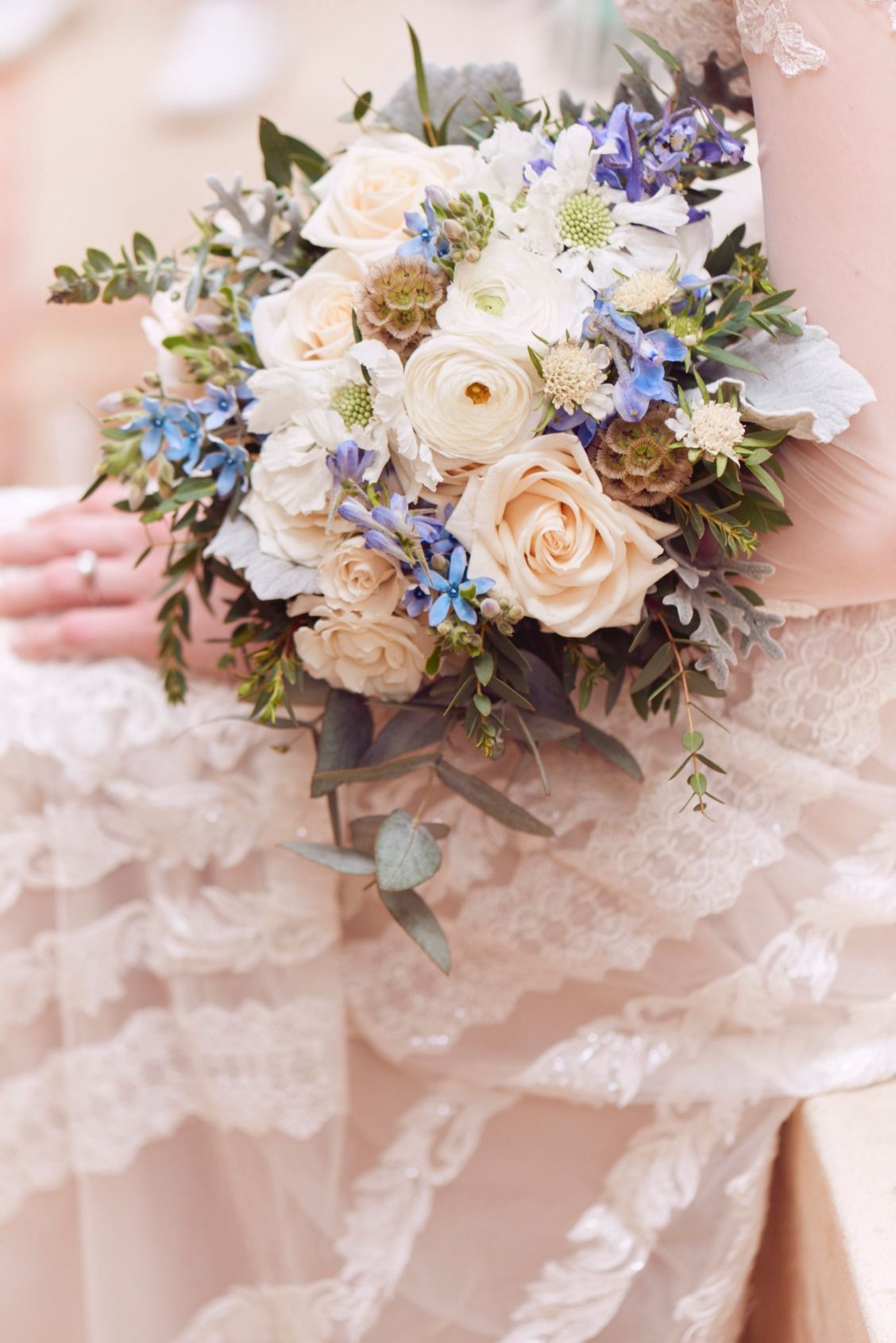 Soft blue and bright white wedding flowers courtesy of our romantic