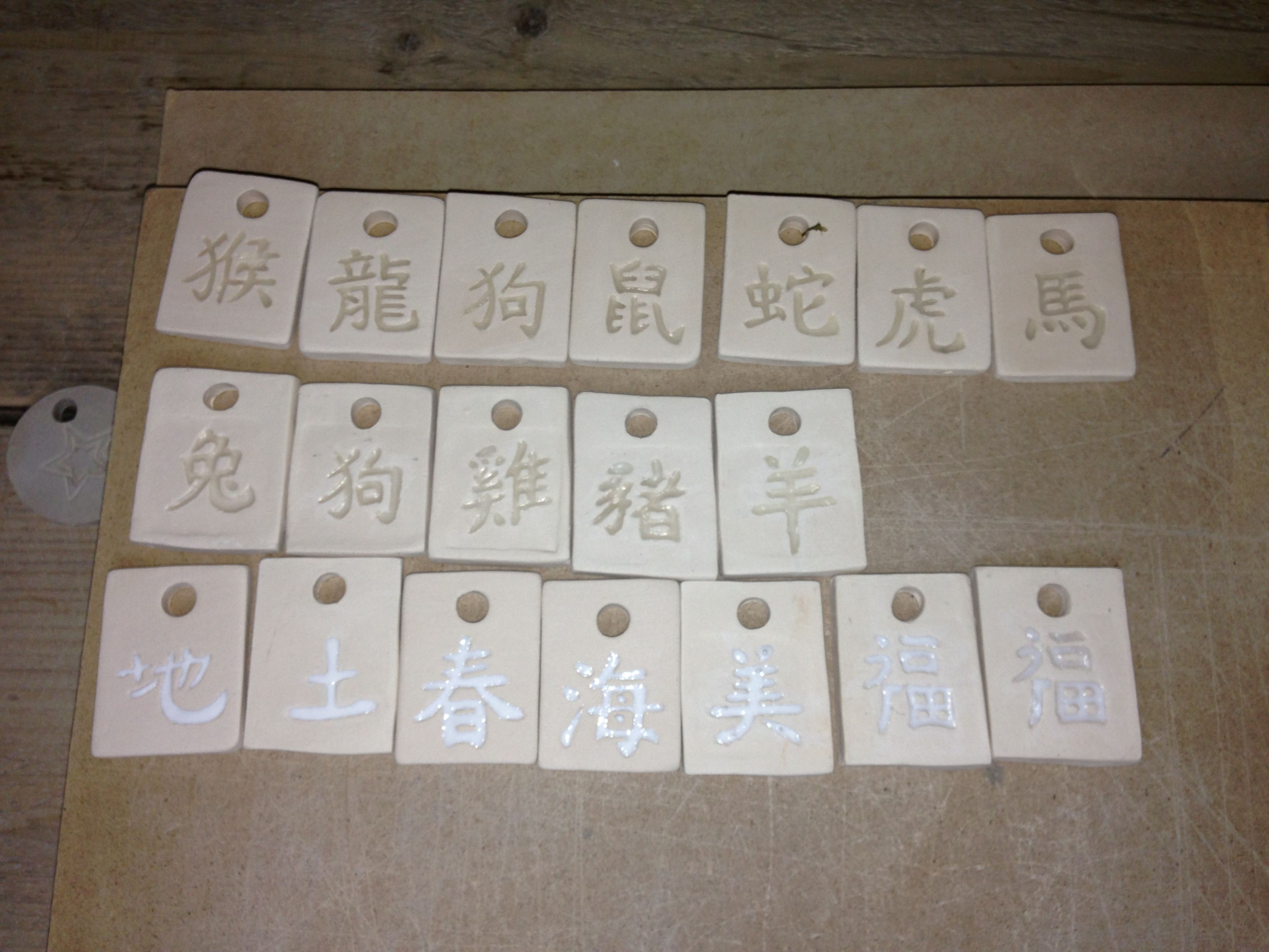 Pendants with wax, ready for glazing