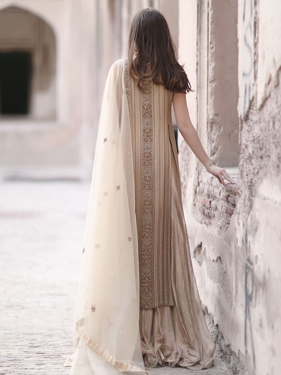 Hand embroidered gold graded tunic with crushed silk lehnga three