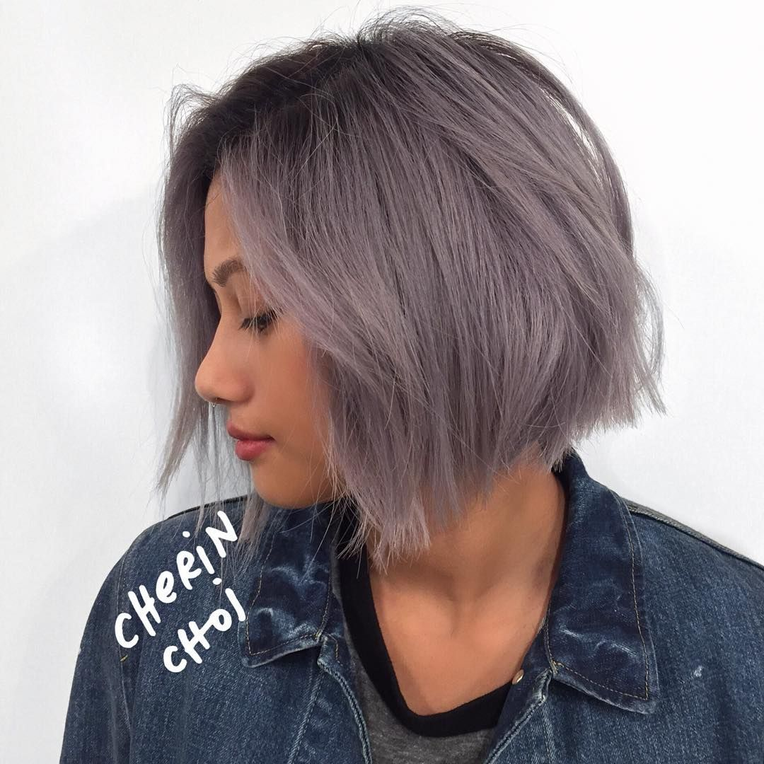 grey hair bleached out from filipino black hair. root left in for