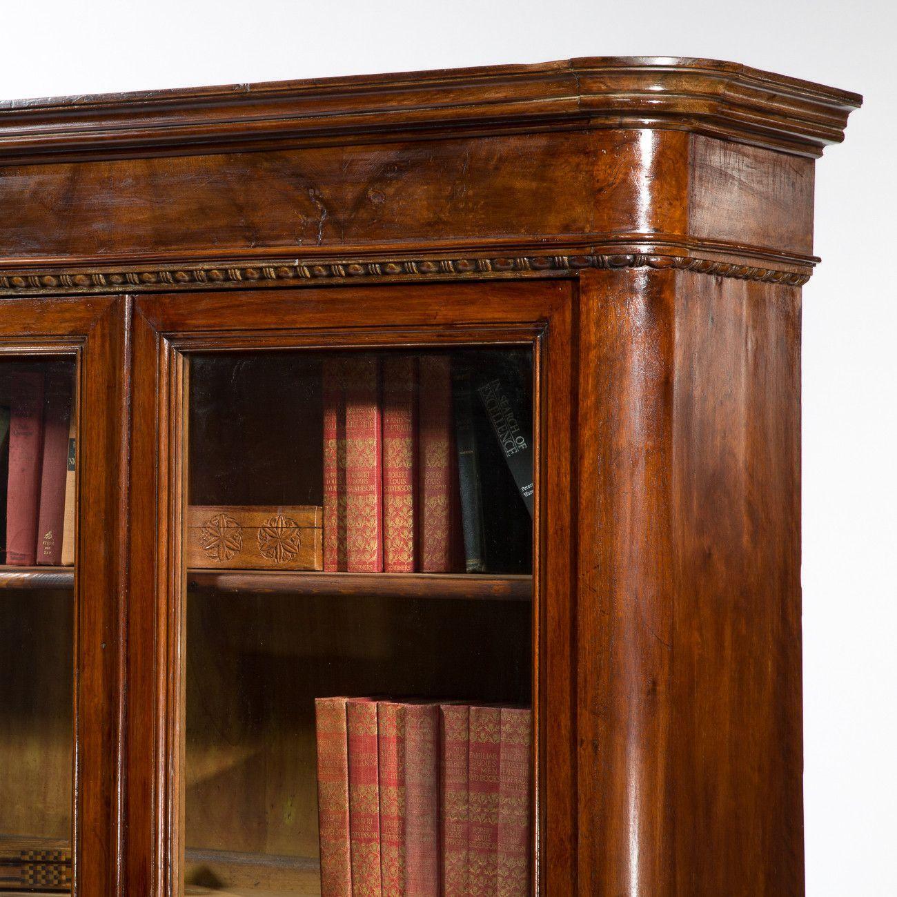 antique italian walnut bookcase with glass doors circa
