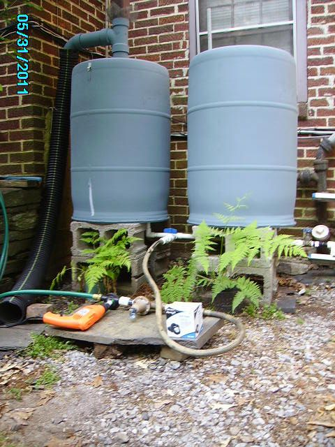 Rain Barrels With Overflow My Free Rain Barrels Drill Pump Pumps Water Up 10 Feet With Instructions Rain Barrel System Rain Water Collection Permaculture Gardening