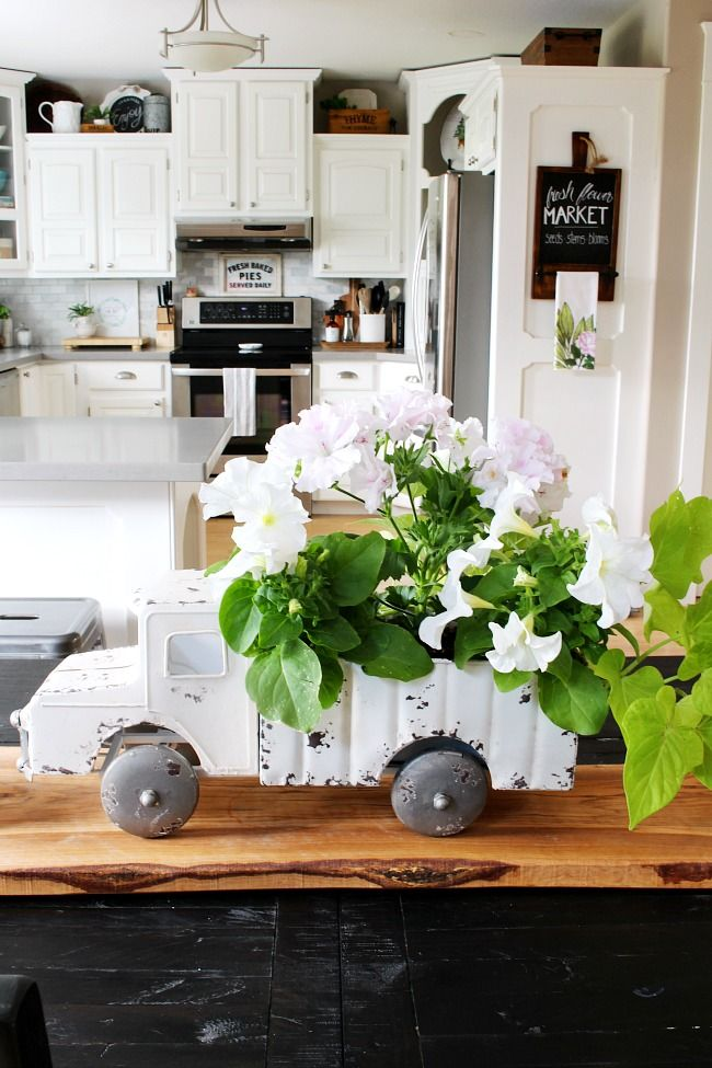 Beautiful summer decorating ideas for the kitchen love this cute vintage truck planter used as  centerpiece summerdecor summerdecoratingideas also and home tour clean rh pinterest