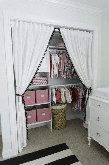Baby room/nursery closet organization idea: I love the idea of making a nursery closet bigger and more usable by removing the closet door(s), but adding this curtain is just brilliant.  Very simple DIY hack that will fit any budget.