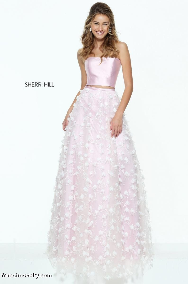 Sherri Hill 50901 is a strapless two piece prom gown with a sheer layered  skirt.