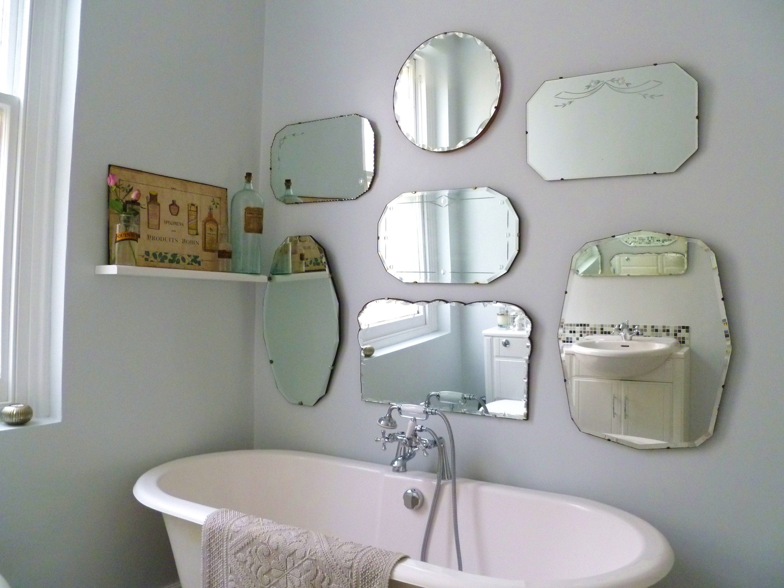 How to hang a display of vintage mirrors more frameless for Mirror screen