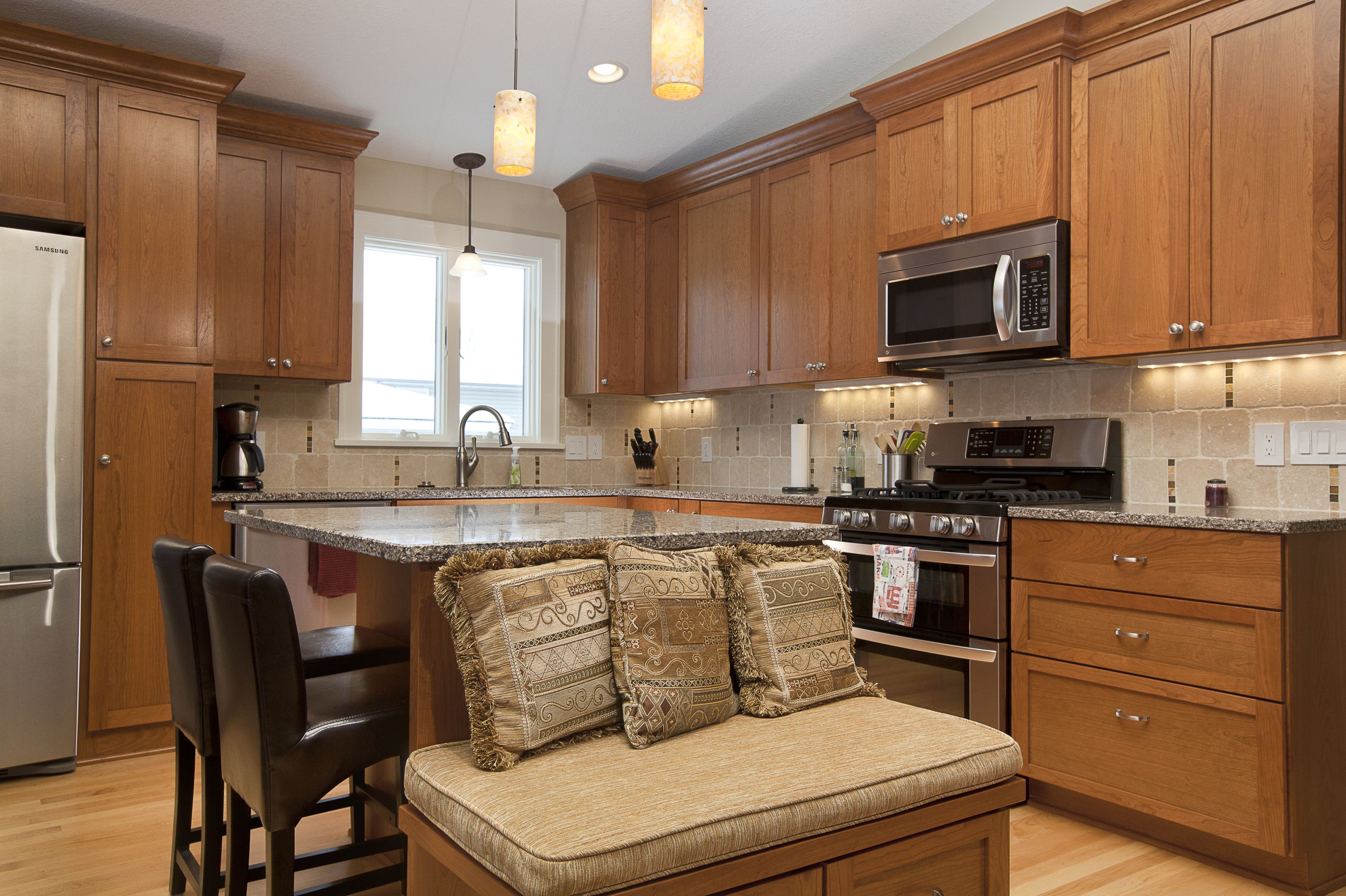 Maple Grove Kitchen Remodel The Couple Wanted To Open Up The Space To The Living Room Create Multi Functional Seating Match Existing Hardwood Floors In Kitchen Split Level Home Designs Kitchen Flooring