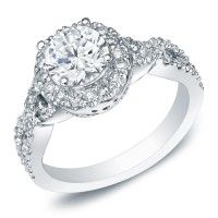 A ring says what words cannot. Tell her what's in your heart with this 14K white gold ladies diamond ring.