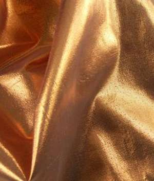 Lame. Used purely for decorative uses and made from a blend usually of metallic and nylon. Can be gold, silver or other bright colors.