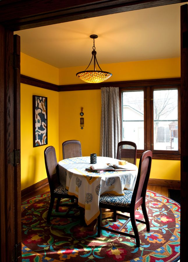 Dining room bright yellow walls with beige ceiling dark for Dark colored rooms