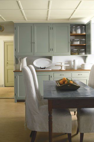 The cosy ambience of a traditional kitchen is enhanced by a serene palette of chalky green hues inspired by the seaside. Cabinet and door: Maid of the Mist CC-728 and Timothy Straw 2149-40, respectively, Benjamin Moore Advance, Semi-Gloss Finish. Ceiling: Seahorse 2028-70, Benjamin Moore Regal Select, Flat Finish. #kitchens #architecture #design