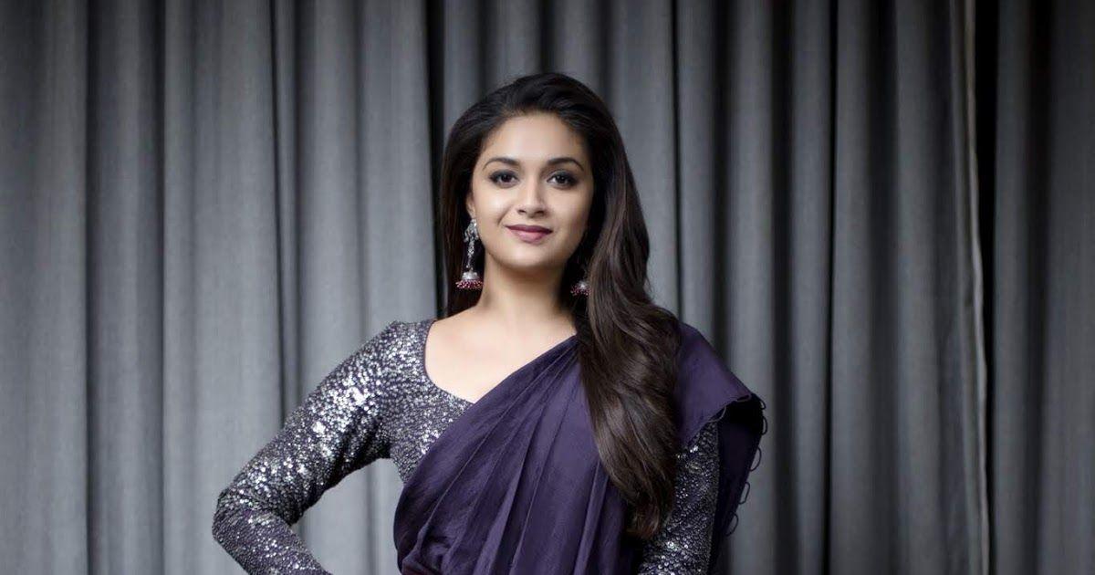 Actress Keerthi Suresh Latest Photoshoot In Purple Saree