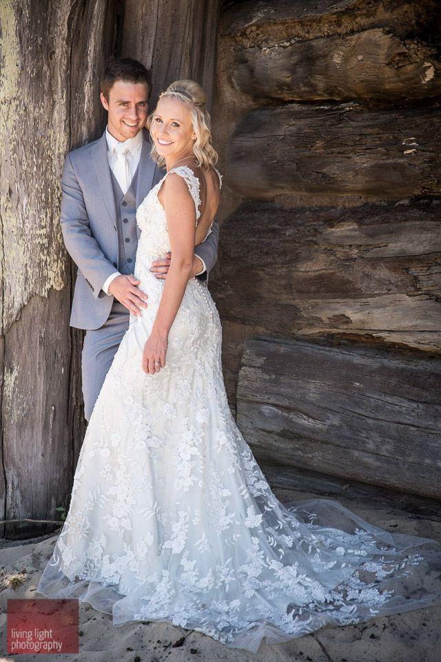 Spurling Allure 8800 lace wedding gown and grey suit at the beach