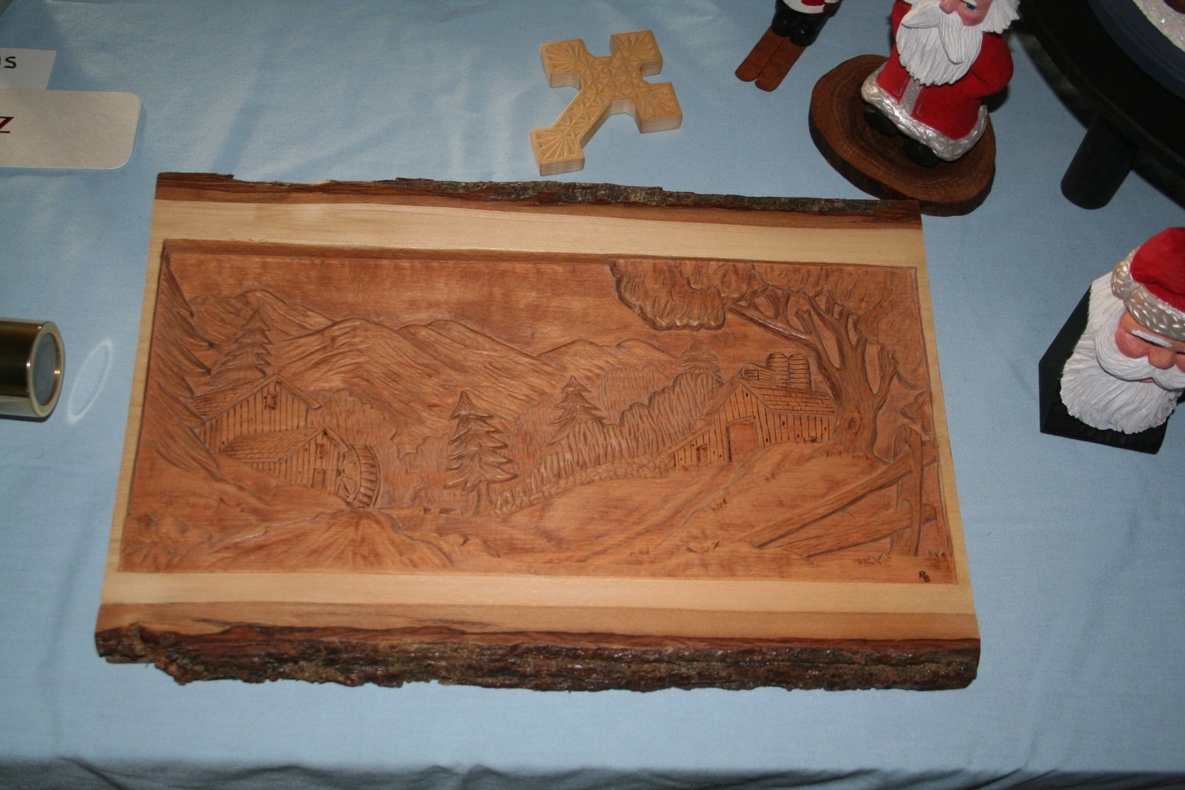 Relief carving on a basswood barkside slab