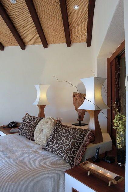 14 Ways To Make Better Use Of Bedroom Corners Safari Bedroom Decor Bed In Corner African Home Decor