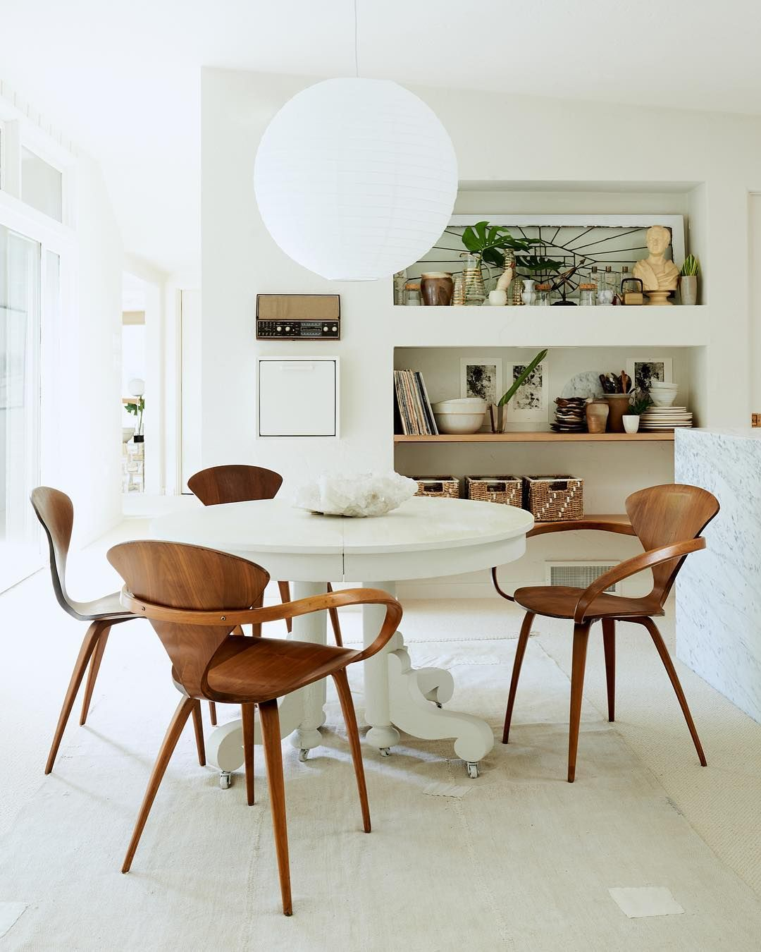 I kinda really love the mix of this table with these chairs where interior designers shop for affordable decor