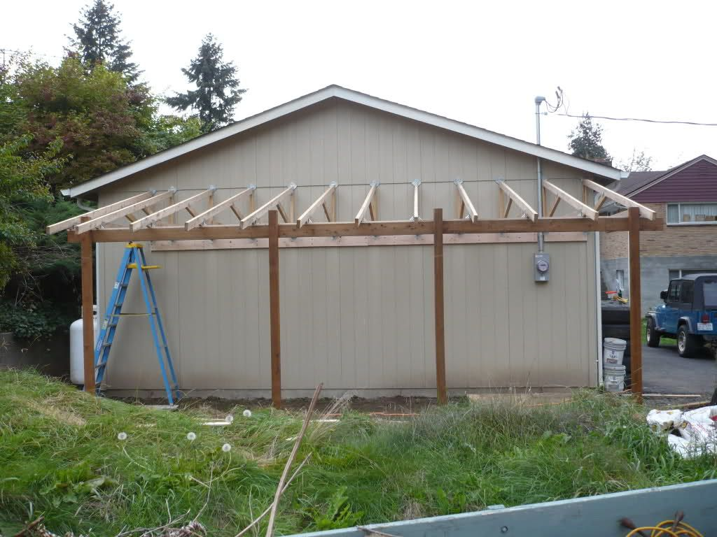 Lean to carport build the garage journal board porch for Building a house out of a pole barn