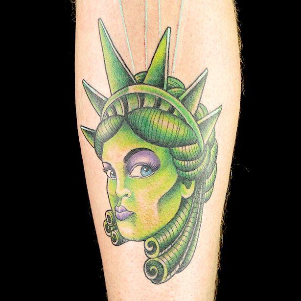 New school statue of liberty tattoo by tuff tito new for Tattoo school listings