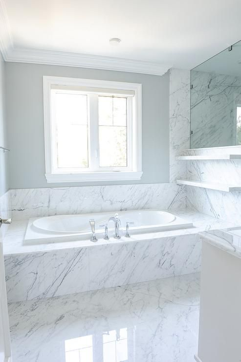 Grey and white bathroom with crown molding features stacked marble