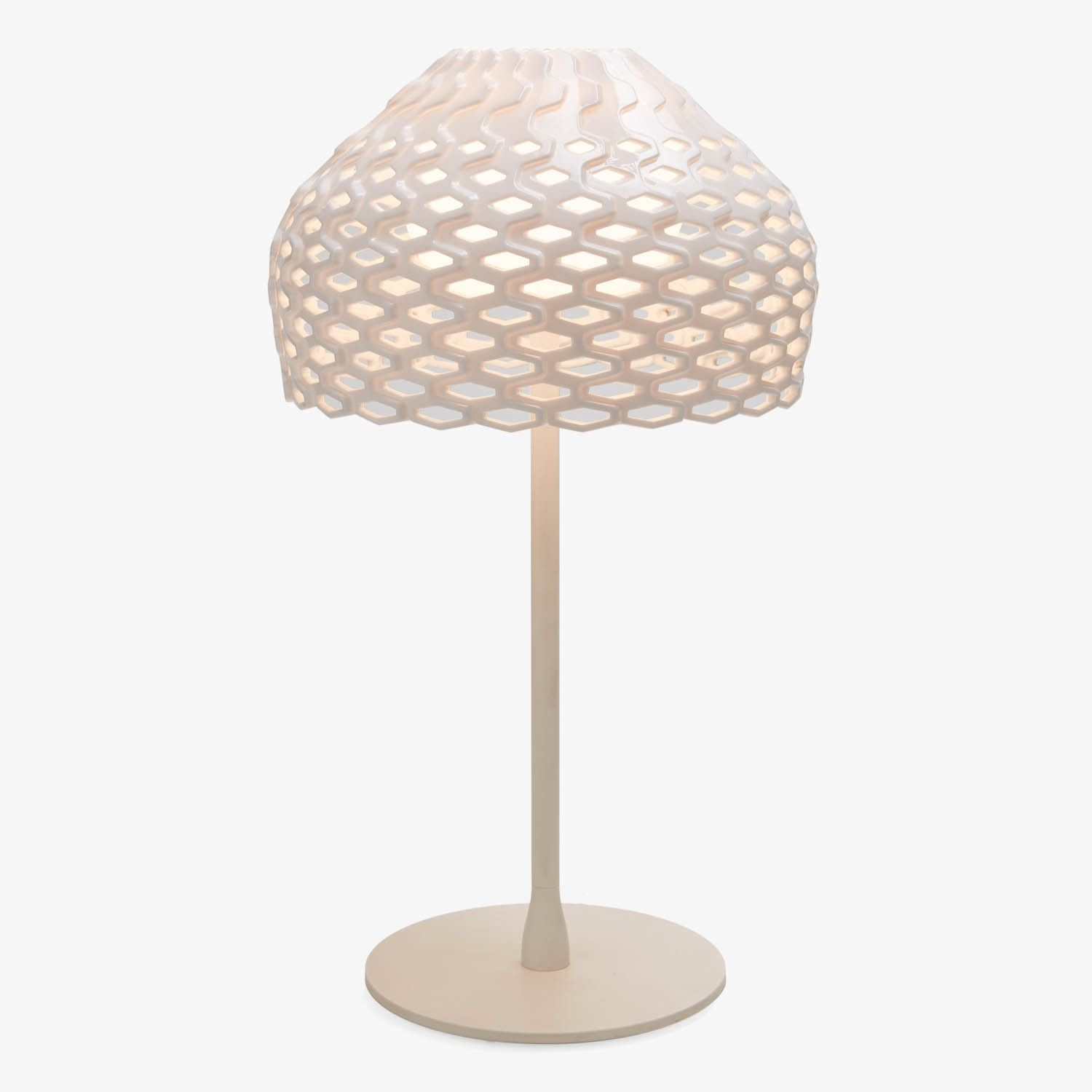 The Tatou table lamp is posed of painted white steel with a high
