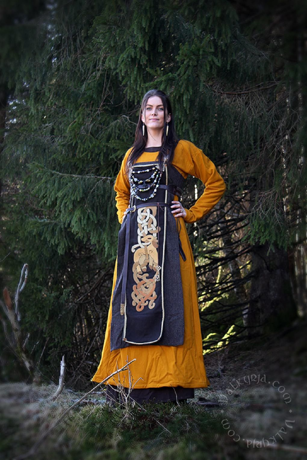 Gorgeous embroidery! http://www.valkyrja.com/ Looks like the embroidery is on a panel pined over the apron dress.