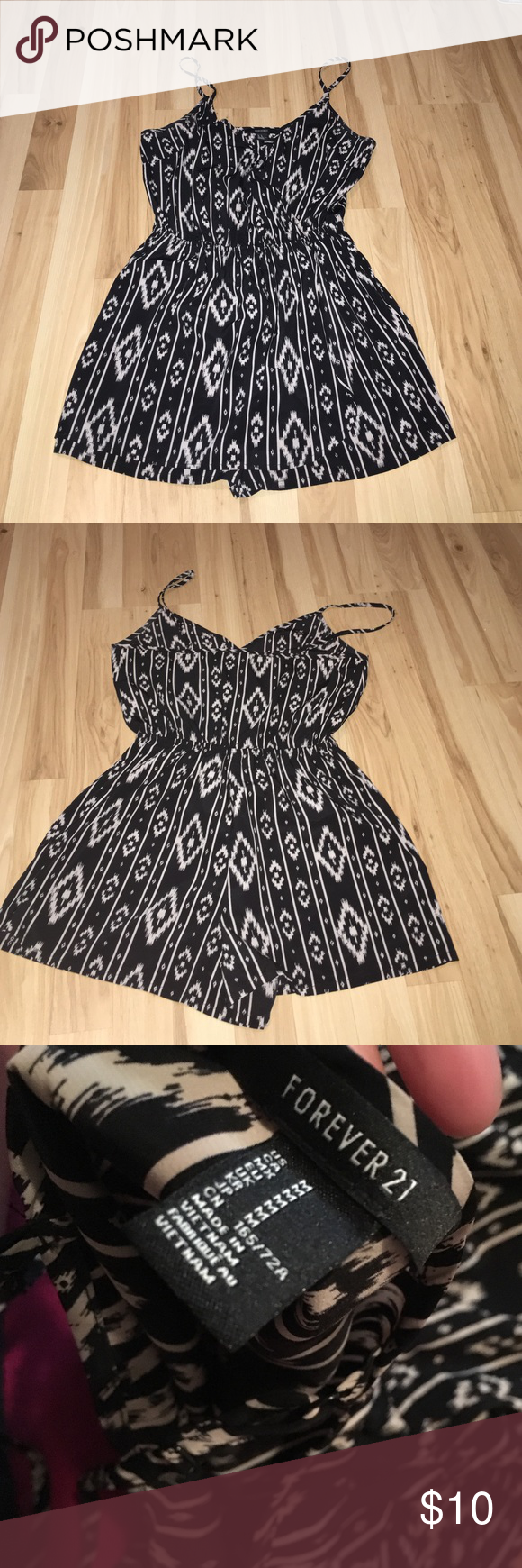Cute Skirt Front Romper from Forever 21 Super cute and comfy romper from forever 21! The front has an extra layer that makes it look like a dress, but it is a romper! Size medium Forever 21 Dresses