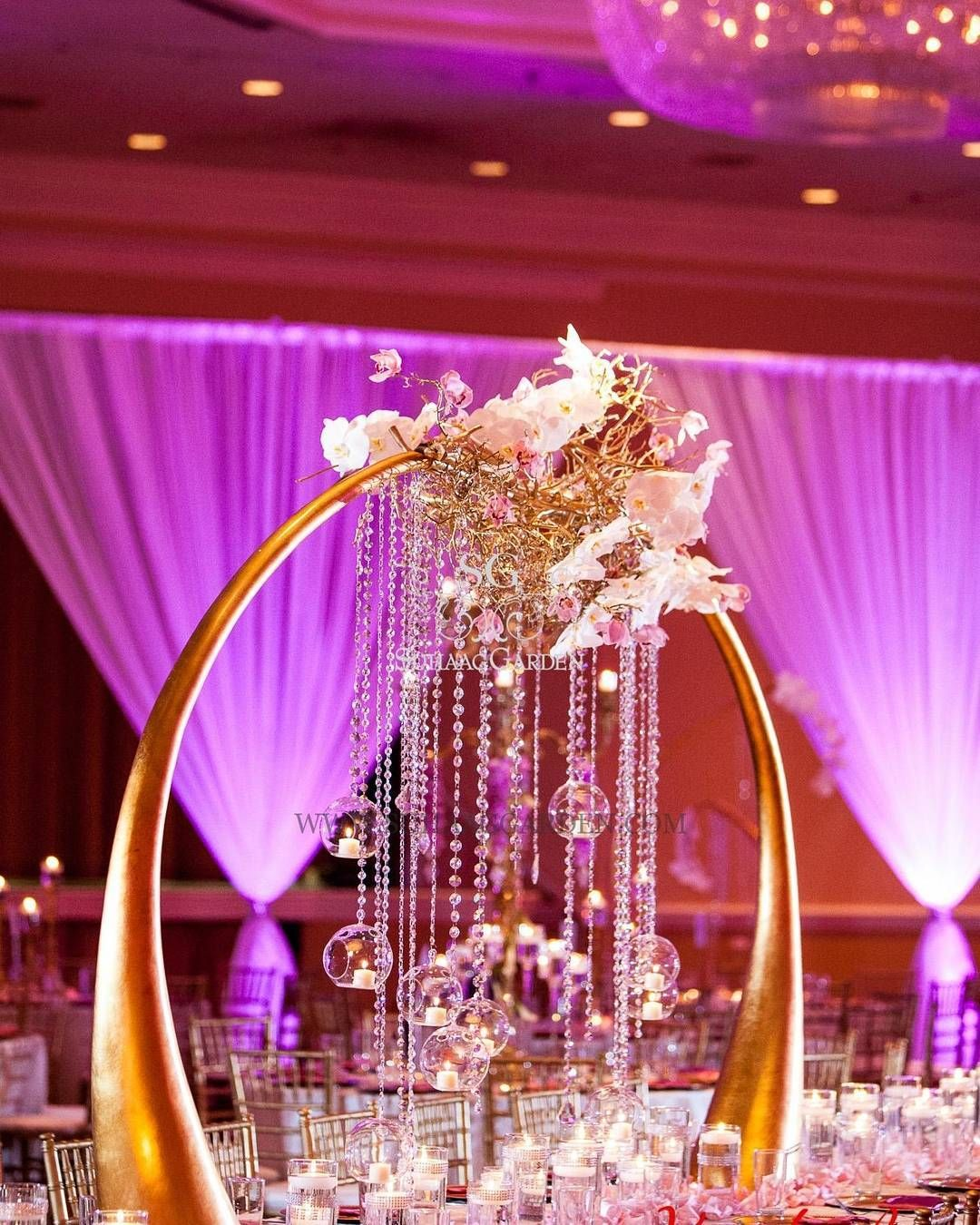 Absolutely gorg centerpiece! Love the #uplight lighting effect on ...