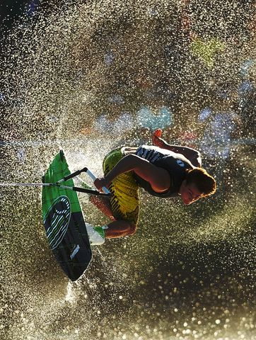 A competitor in action during the Mens Wakeboard event in the Moomba Masters Water Ski International Invitational Championships during the Moomba Festival on March 12, 2012 in Melbourne, Australia. The 2012 Moomba Parade is themed ?Melbourne is delicious,? with floats, music, local community groups and performers taking part. (Photo by Scott Barbour/Getty Images)
