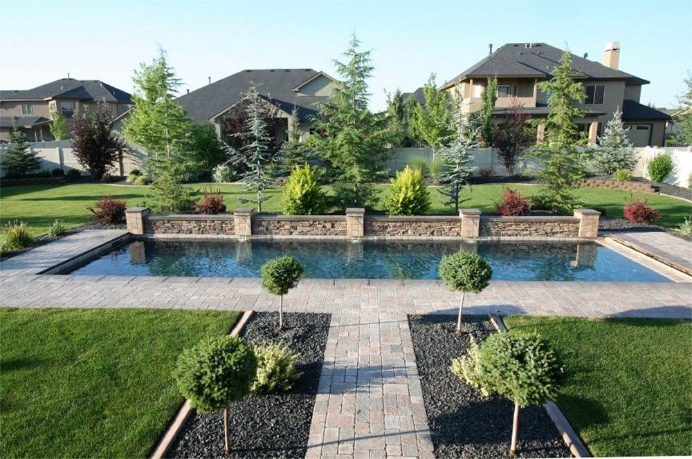 Lap pool with raised stack stone beam and columns pebble Lap pool ideas