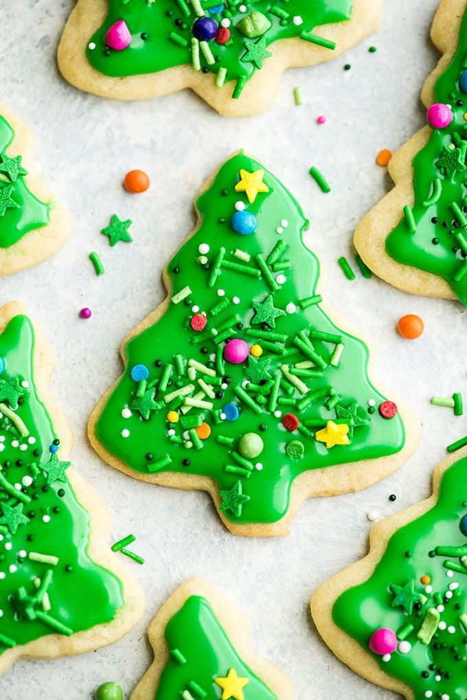 The Best Cut Out Sugar Cookie Recipe! They are soft, chewy and don't spread! Plus an easy sugar cookie frosting that tastes great and hardens with a beautiful shine that's perfect for decorating! Making these easy decorated sugar cookies has been our family's holiday baking tradition for 30 years! #sugarcookies #cutoutsugarcookies #christmascookies #christmas #baking #cutoutcookies #sugarcookiefrosting #recipe
