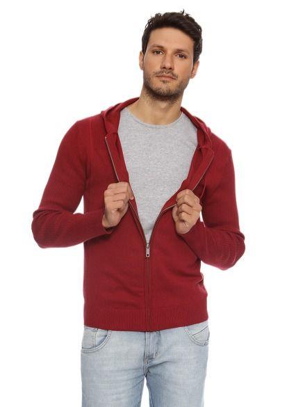 Tricot liso com detalhes nas mangas , gola e punho, parte superior traseira em sarja e fechamento por tr