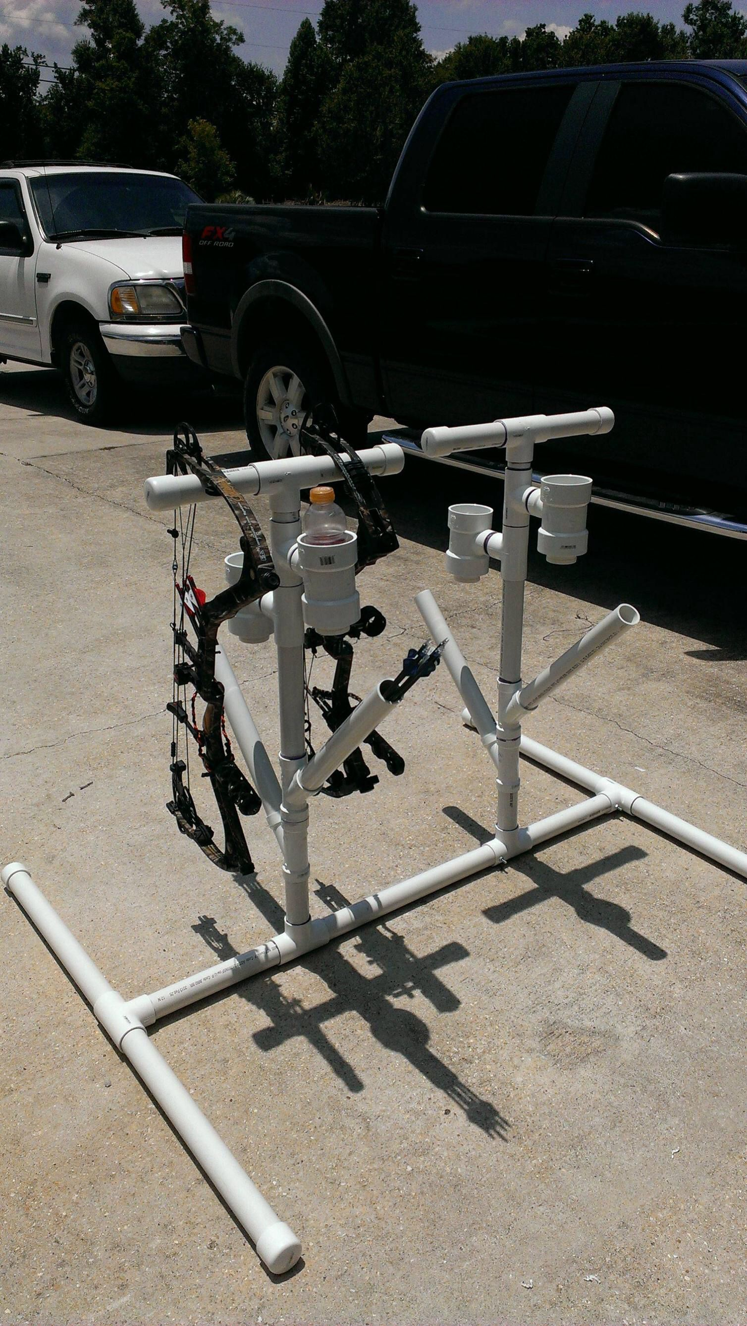 PVC bow stand with quiver and bottle holder outdoors