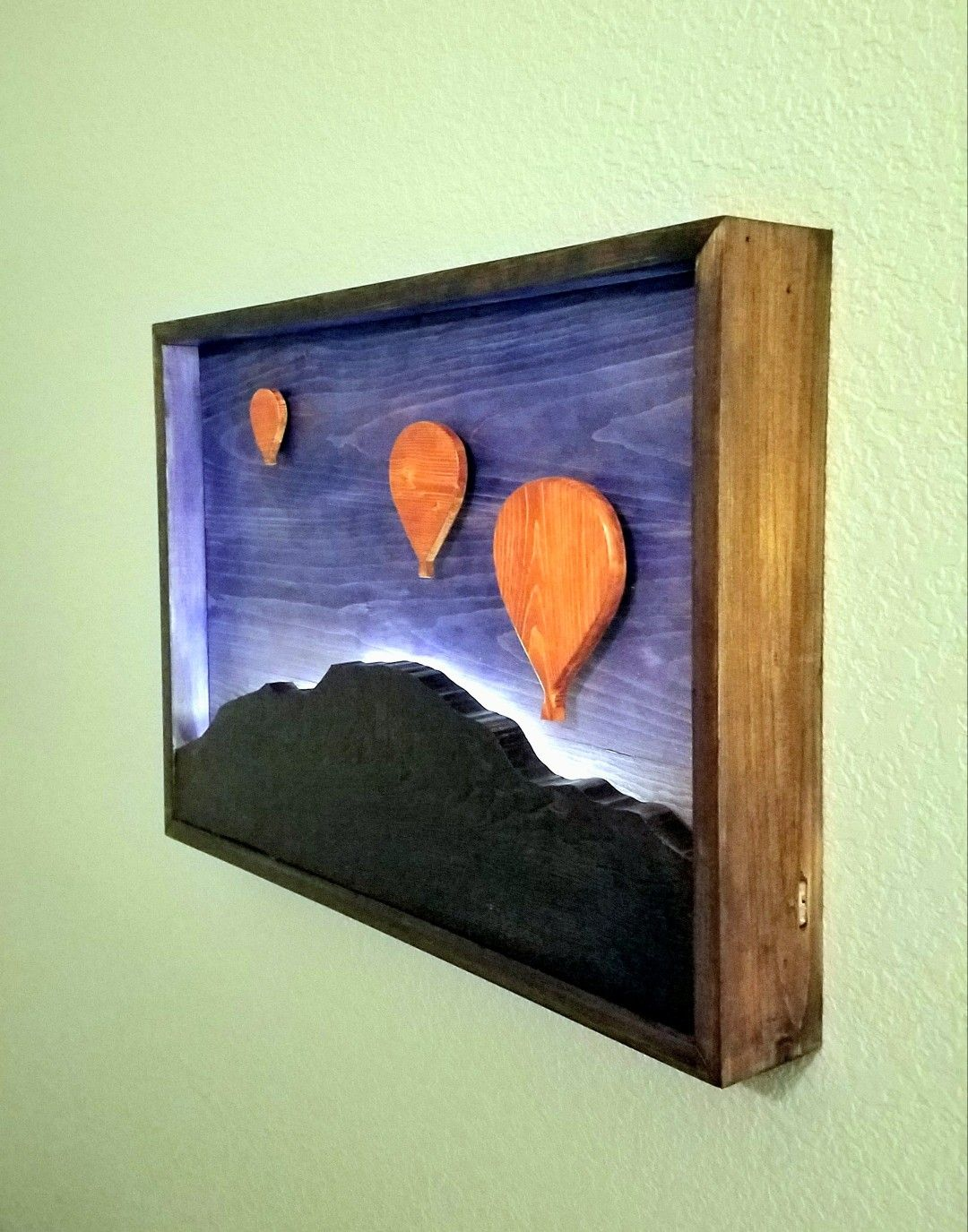 Wood wall art. Hot air ballons floating above Sandia