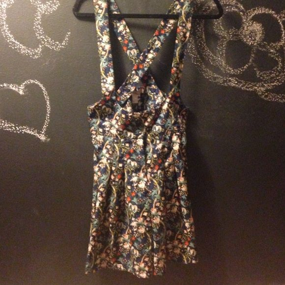Floral overall romper Pretty floral shorts, romper with ties in the back.  Never worn! Forever 21 Other