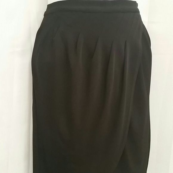 1ec4d0e18e Laundry Knit Tulip Skirt Black knitted tulip skirt. Featuring asymmetrical  soft pleats that drapes lovingly over the body while hiding any body ...