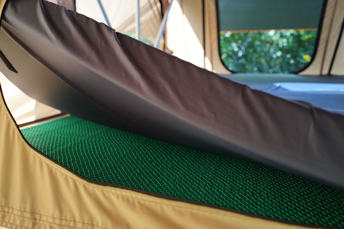 The green thing that you see below the rooftop tent mattress is an anti condensation mattress. What does it do? Prevent condensation in your mattress while ... & The green thing that you see below the rooftop tent mattress is an ...