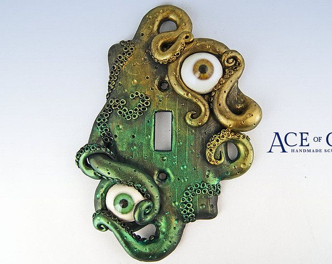 This light switch plate was hand sculpted and painted over a standard one gang toggle switch wall plate. The surface features a steampunk style multi-metal base with vibrant indigo blue tentacles. The tentacles reaching out from behind create unique swirls and shapes complementing the overall look and feel of this piece. The piece has been sealed with two coats of high quality indoor/outdoor matte/satin varnish to prevent wear. Your switch plate will arrive with two screws for insta...