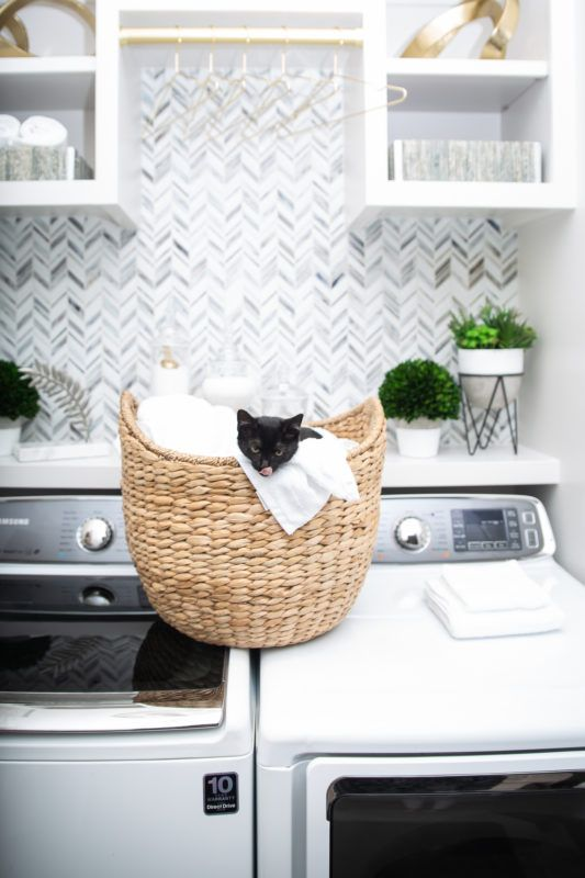 Laundry Room Makeover: Built-In Top Loader Washer and Dryer. Brass accessories in front of this tile accent wall and a kitty in a basket, need I say more? This utility room transformation will wow you #graylaundryrooms