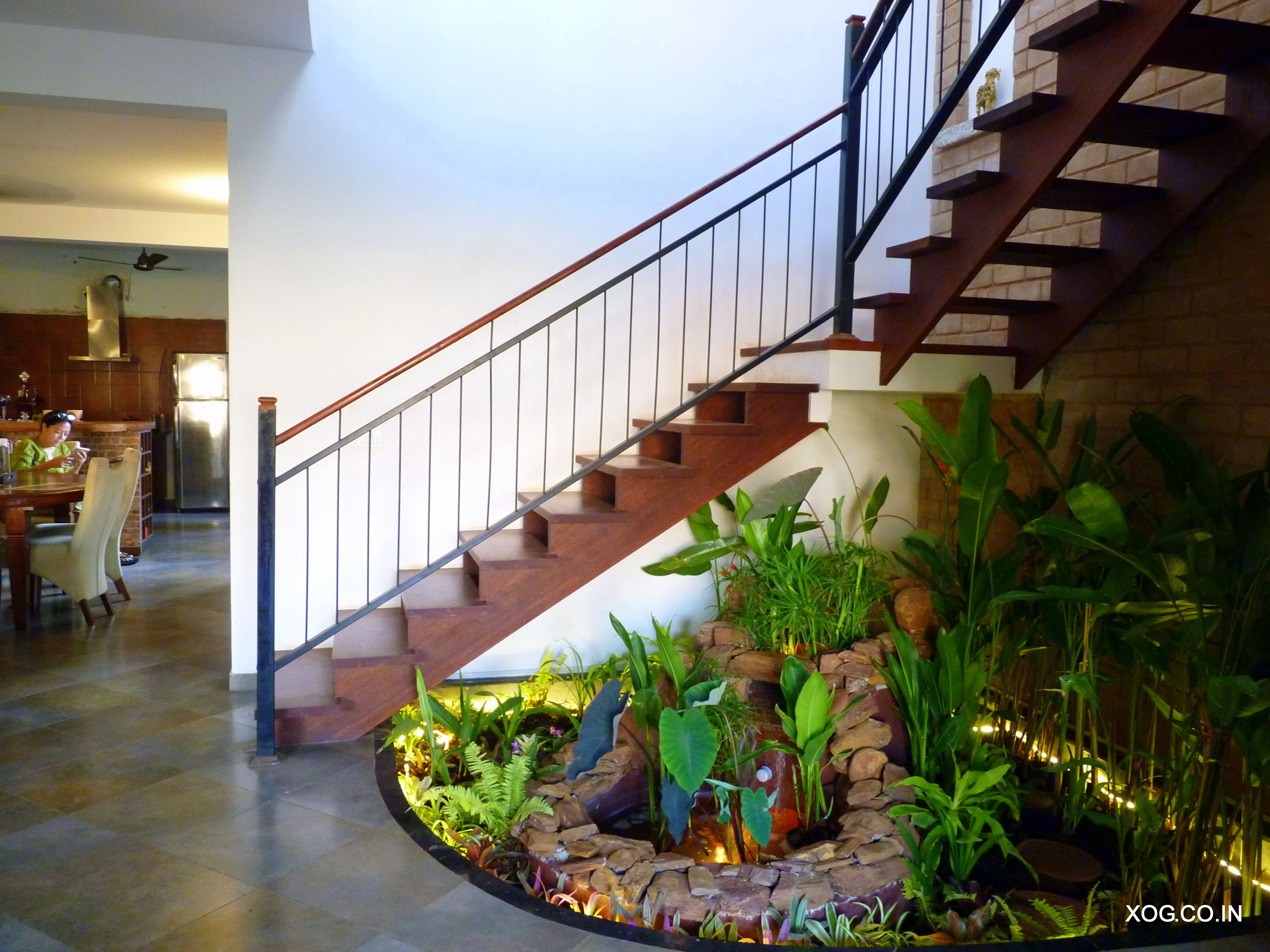 Tropical Garden With Rock Water Feature Under Staircase Xog S