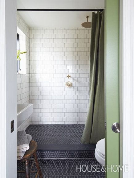Photo of brass bathroom fixtures – Mandy Milk's master bath with gray-grouted white squar…