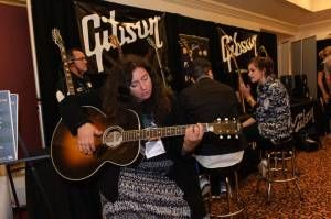 @Gibson Guitar giving attendees hands one experience with the merchandise. #NMS2013