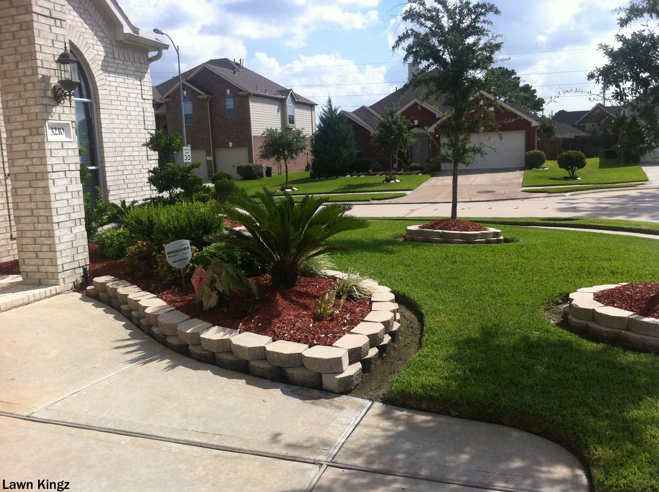 cement driveways and curbing blend very well with beautiful lawns
