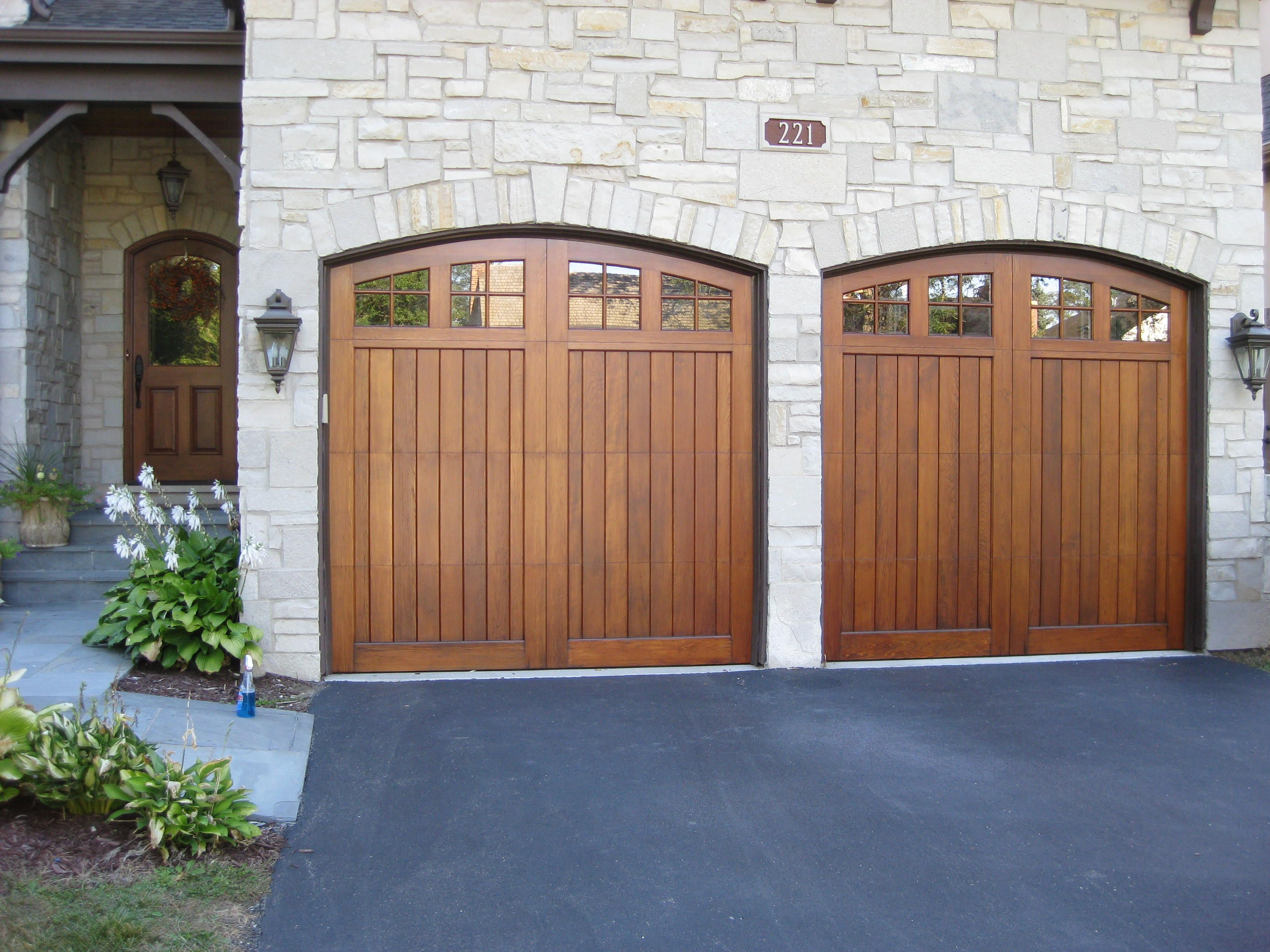 Stripping and refinishing of two wood garage doors http for Best wood for garage doors