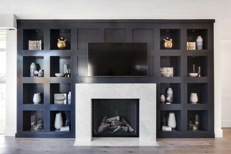 Stunning Black Built In Niche Shelves Surround A White Marble Fireplace Mantel With Interior Blac Fireplace Design Coastal Living Rooms Black Fireplace Mantels