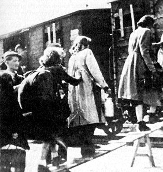 Jews of the Lodz Ghetto at Radegast (Radogoszcz) Station beginning their last life  journey  to Auschwitz death camp