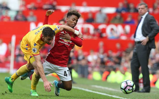 Angel Gomes Of Manchester United In Action With Joel Ward Of Crystal Palace During The Premier League Match Between Manch Manchester United The Unit Manchester